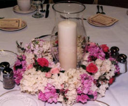 A floral wreath and candle centerpiece