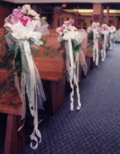 pink and white pew decorations