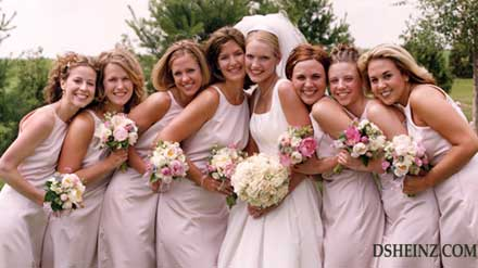 a bridal party shows off their bouquets